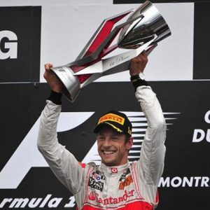 Jenson Button holding the Canadian Grand Prix Trophy